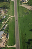 Country road and Green field aerial view poster