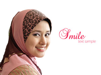 Beautiful Muslim woman was glanced with sweet smile