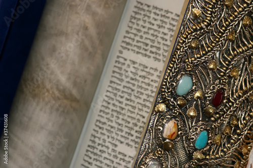 Beautifully decorated Torah scroll.