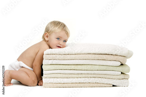 Baby girl resting head on towels
