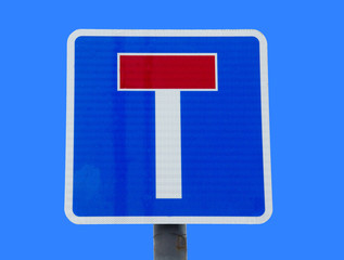 dead end sign on blue sky