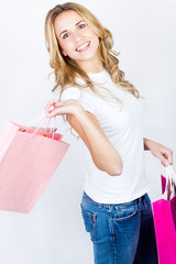 Happy shopping girl. Isolated over white background.