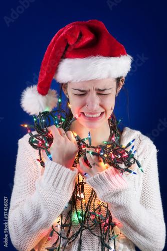 Panicked girl with Christmas lights - 37436827