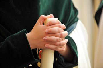 Procesión de Semana Santa en España, manos unidas
