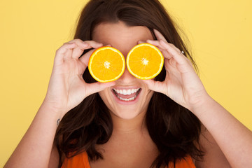 Laughing Woman With Orange Slices Over Eyes