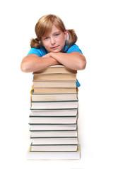 Cute schoolgirl with book.