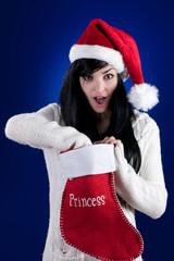 Beautiful girl with Christmas stocking