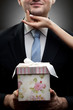closeup portrait of businessman holding gift with womans hand