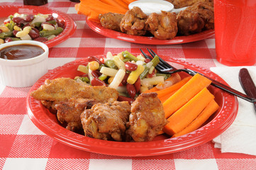 Chicken wings and bean salad