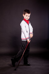 Boy in official dresscode with a putter