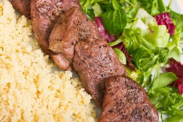 Tenderloin steaks in wine sauce with cadamon and kuskus groats
