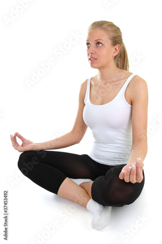 beautiful woman doing yoga isolated over white