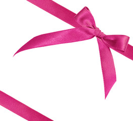 pink ribbon on white background with space