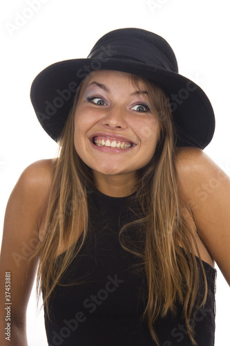 Young woman in a black hat on a white background