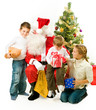 Santa Claus giving Christmas gifts to children