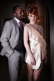 Fashion business dressed couple standing