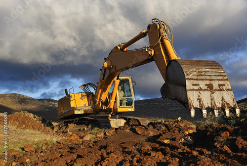 Excavator working on a mountain
