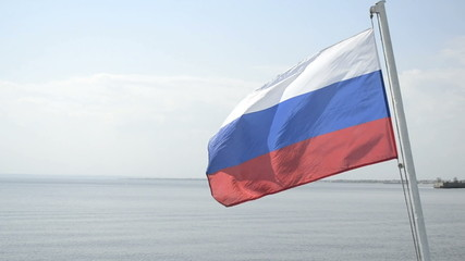 Russian flag flutters on nature
