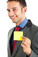 Businessman showing post-it