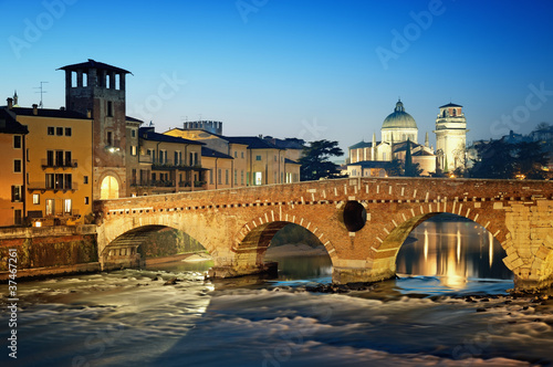Ponte Pietra and the River Adige at night..