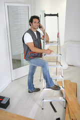 artisan or handyman at phone
