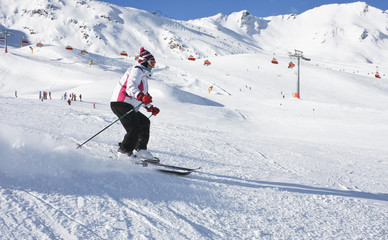 The woman is skiing at a ski resort Solden