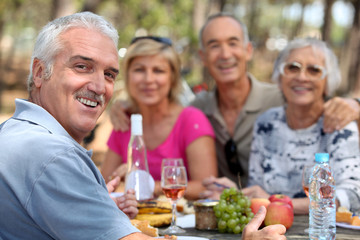 Older couples enjoying an alfresco lunch