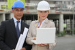 businessman and female assistant on a construction site