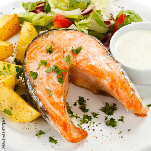 Grilled salmon, baked potatoes and vegetables