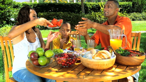 African American Family Healthy Eating in Garden