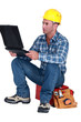Distraught tradesman reading his emails
