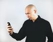 Man Grimacing at Smartphone