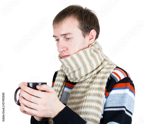 man warming up with hot tea in wintertime