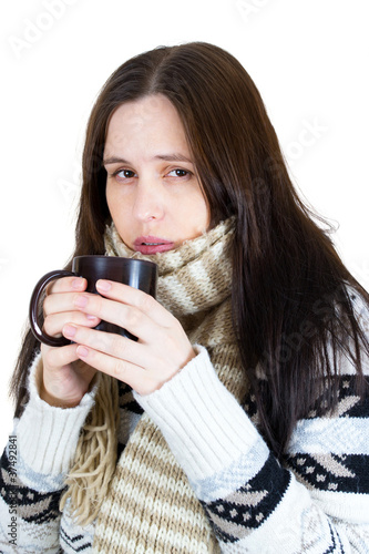 young winter girl drinking hot tea, isolated on white