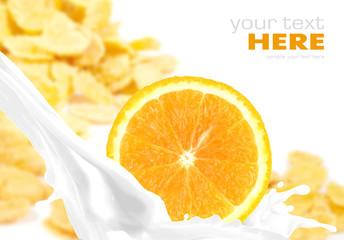 Milk splash with orange on corn flakes background