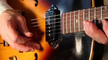 Playing jazz electric guitar X closeup