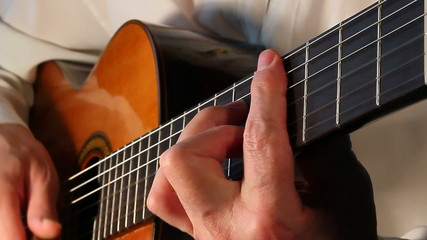 Classical guitarist playing  X closeup