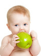 Quadro Baby boy holding and eating green apple, isolated on white