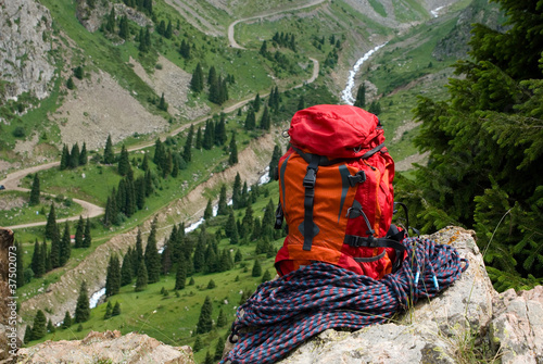 rucksack and rope on background of the mountain valley