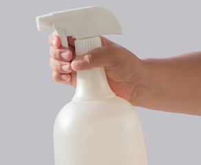 hand and spray bottle isolated