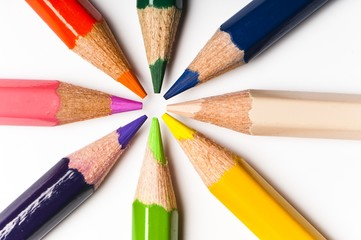 close up detail of star arranged multicolored pencils