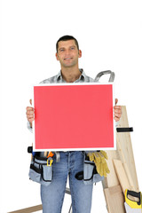 Builder holding red message board