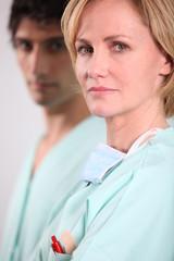 Blond nurse stood with male colleague