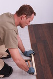 Carpenter installing parquet flooring