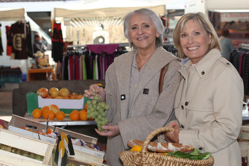 two senior women shopping at the market