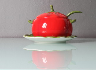 Red cheese bowl like a tomato