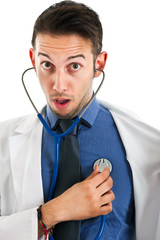 Doctor with stethoscope checking his own heartbeat