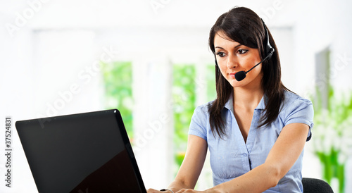Call center operator using laptop