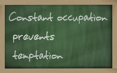 """ Constant occupation prevents temptation "" written on a blackbo"