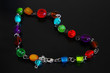 glass bead necklace on dark background